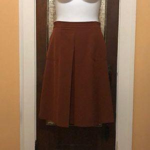 Center pleat side pocket skirt